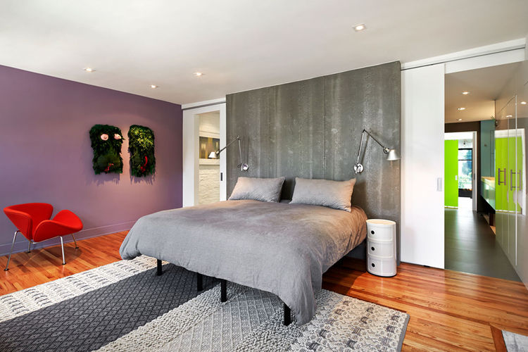 Renovated DC Row House bedroom with wood floors and Viroc headboard.