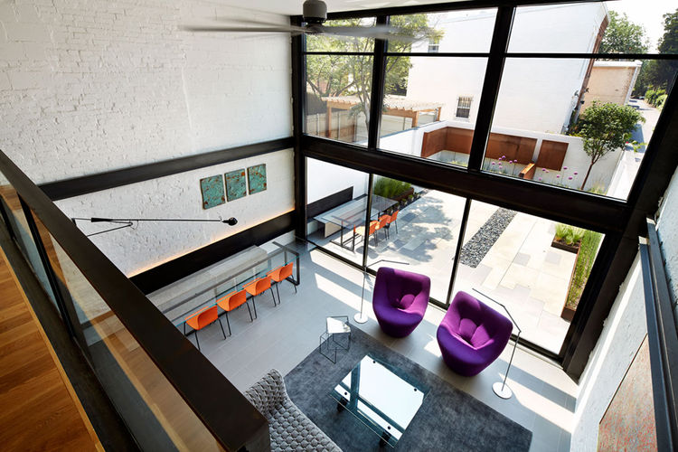 DC row house renovation with double height living room, UV and heat resistant glass.