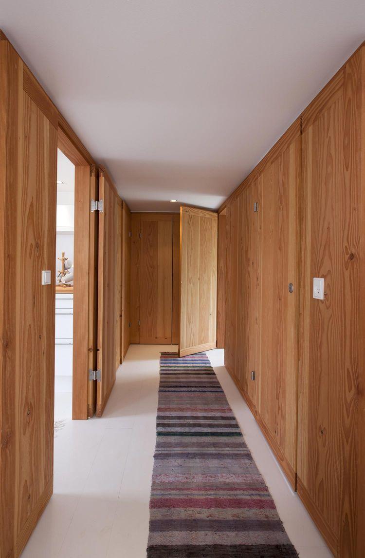 Modern hallway with a striped rug