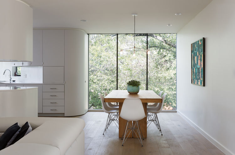 Design Within Reach table and Eames chairs in dining room of Texas renovation by Arbib Hughey Design.