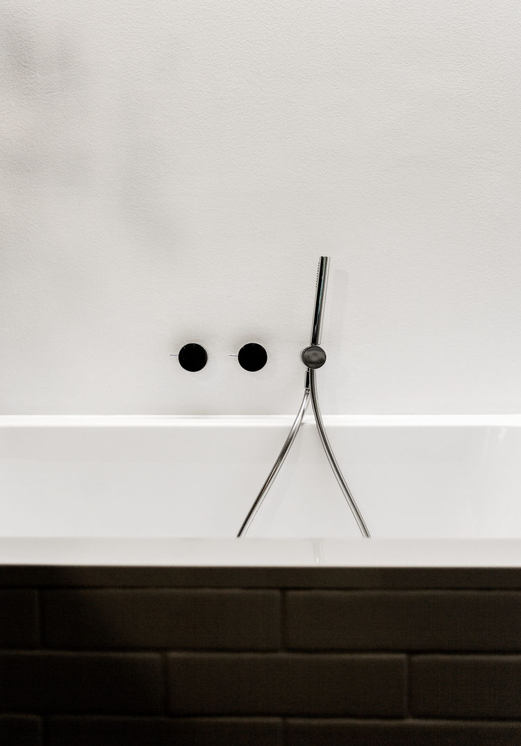 Fixtures by Naoto Fukasawa for Aboutwater over Villeroy & Boch tub.