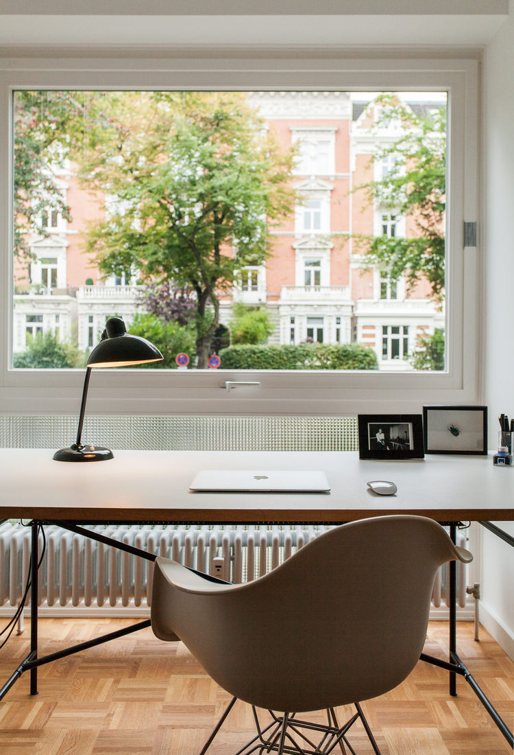 Home office with Egon Eiermann-designed desk and Eames chair.