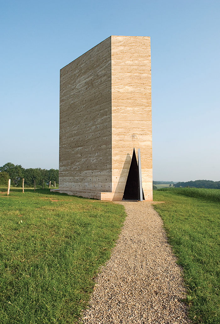 Modern religious architecture like Bruder Klaus Chapel by Peter Zumthor that is made of concrete and charred wood interior