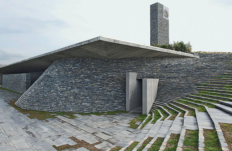 Modern religious architecture like the Sancaklar Mosque built on a hillside with stacked slate