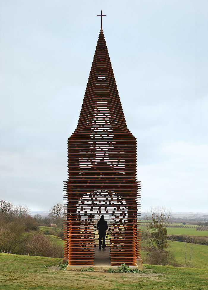 Modern religious architecture like see-through chapel made of cor-ten steel