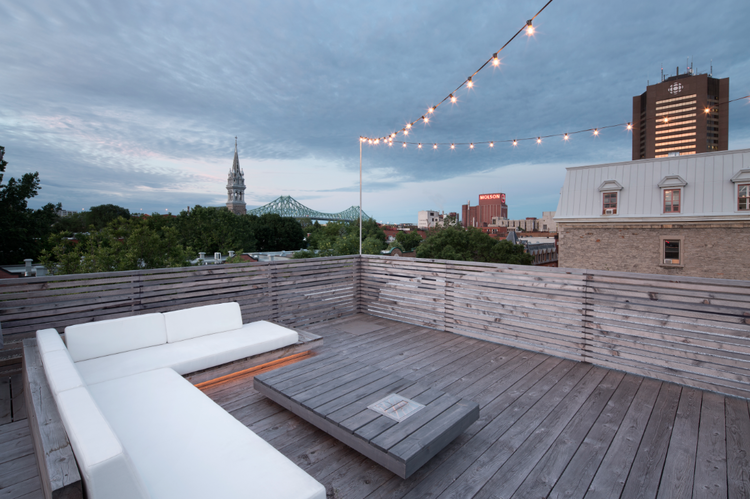 Douglas Fir deck and view of Jacques Cartier Bridge in Montreal renovation by Anne Sophie Goneau