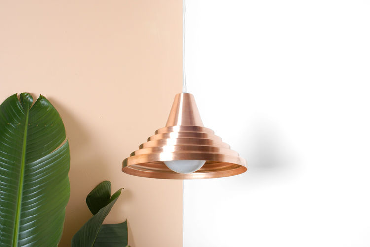Spun copper pendant light with sculptural detail