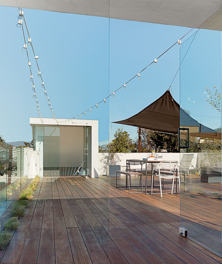 roof deck with Mangaris plank wood flooring and Kookaburra Shade Sail