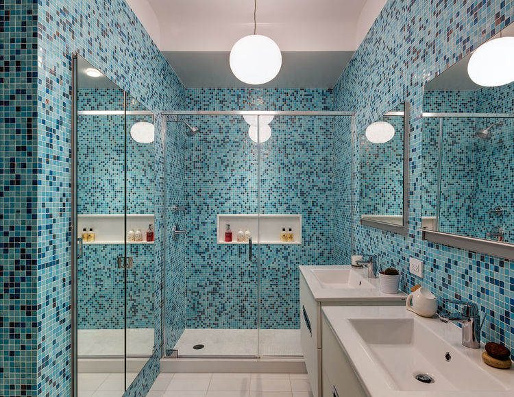 Blue mosaic tiled bathroom