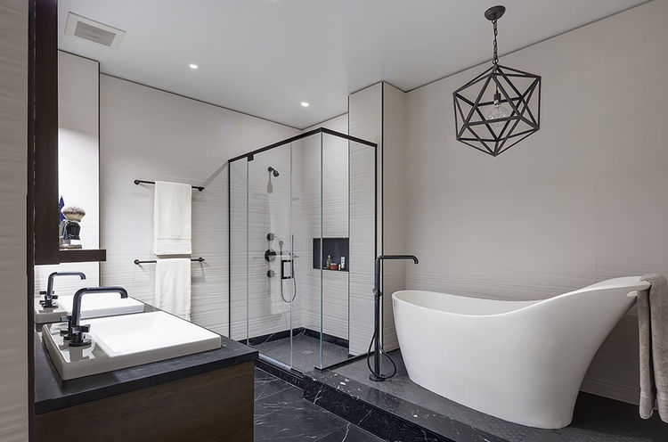 Master bathroom with a freestanding tub and marble floors