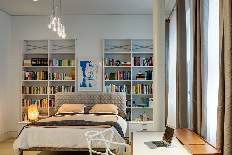 Master bedroom in Brooklyn with ample shelving