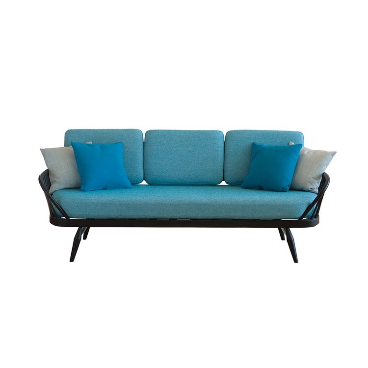 Streamlined sofa with pronounced steam bent frame