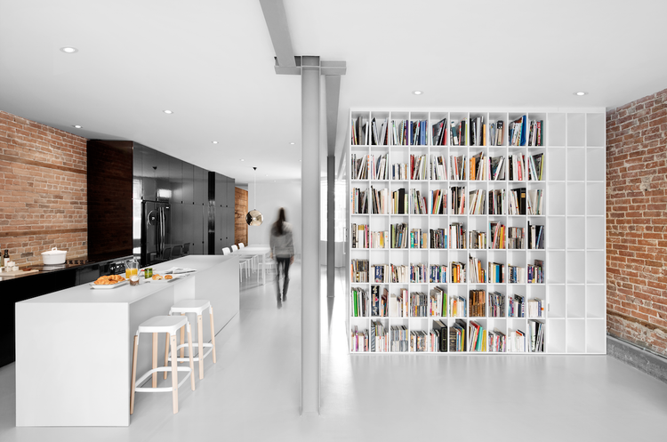 Modern Montreal apartment with a giant bookshelf