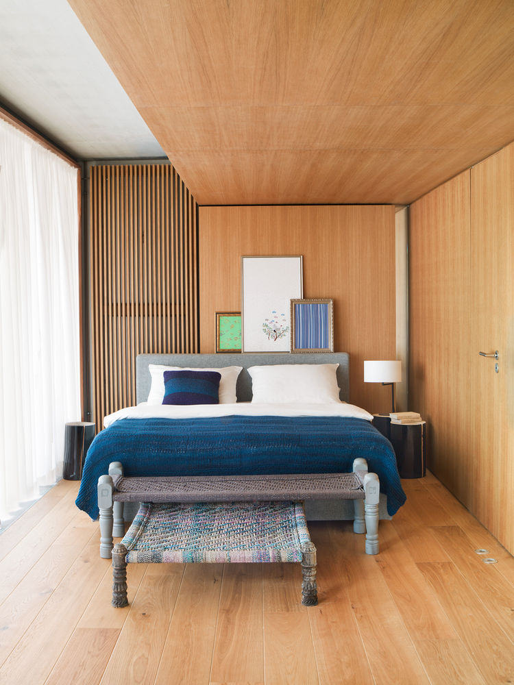 Oak-lined bedroom in a small Berlin apartment