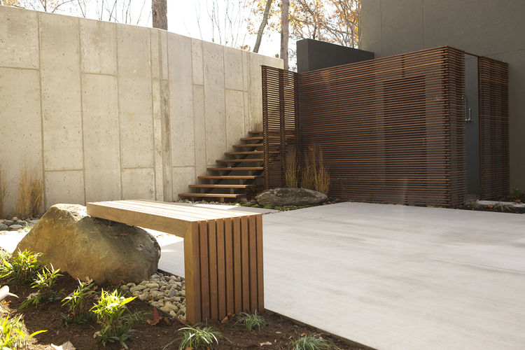 modern courtyard ipe wood bench concrete