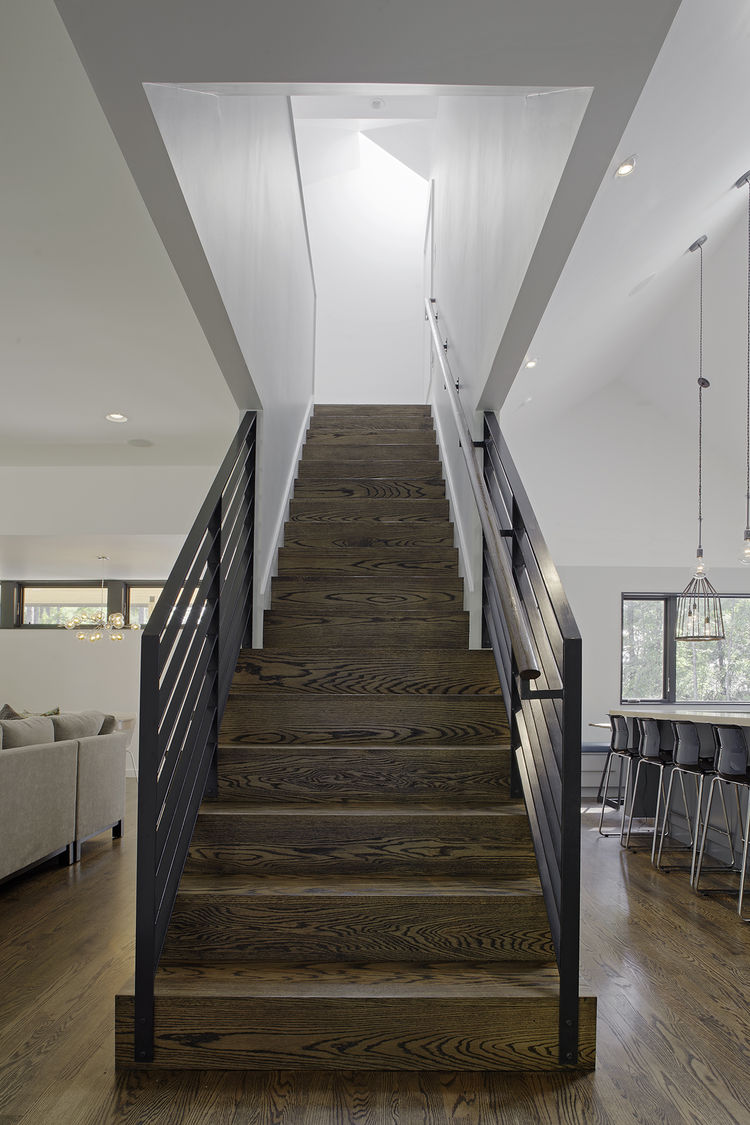 Stained oak stair with painted steel rails.