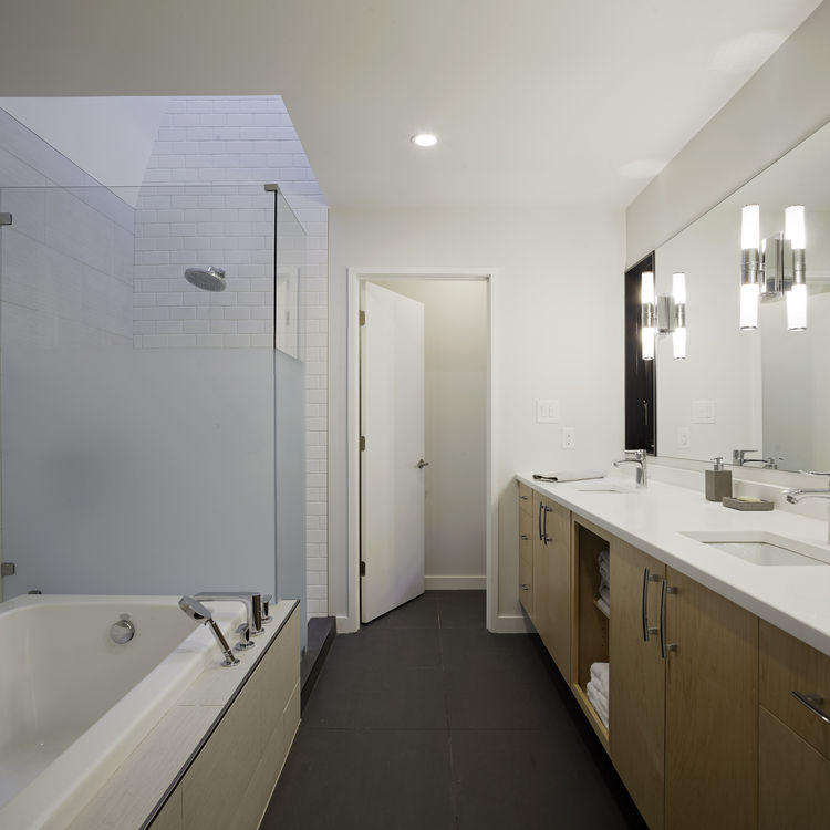 All-white bathroom in modern North Carolina home.