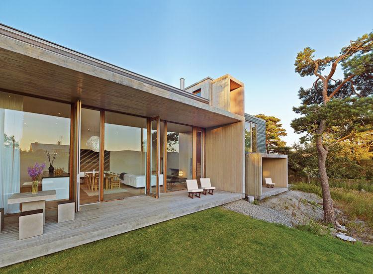 modern fjallbacka sweden pine boxes vacation facade