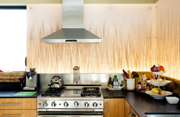This kitchen includes backlit Bear Grass panels from 3form