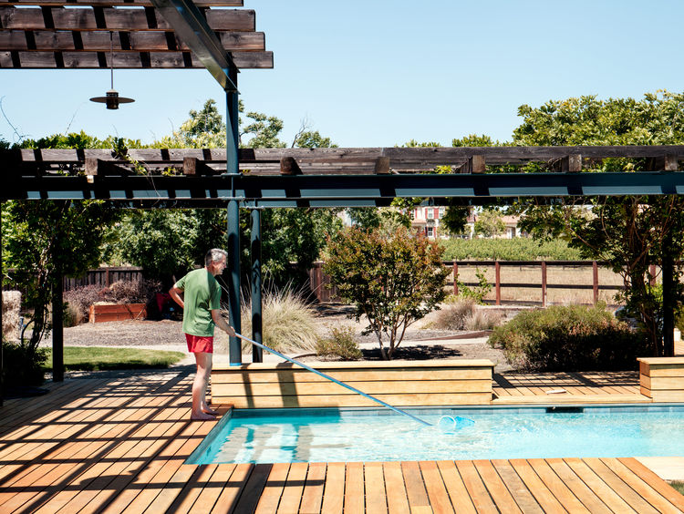 Pool surrounded by a garapa-wood deck