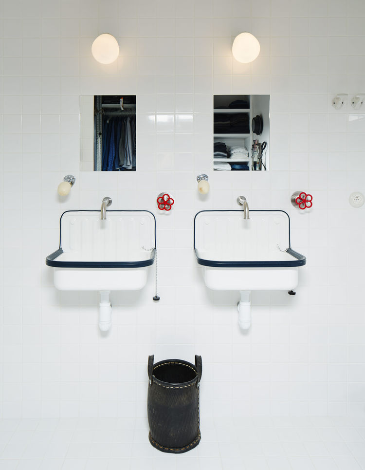 Twin sinks from Labour and Wait in a Paris apartment's bathroom