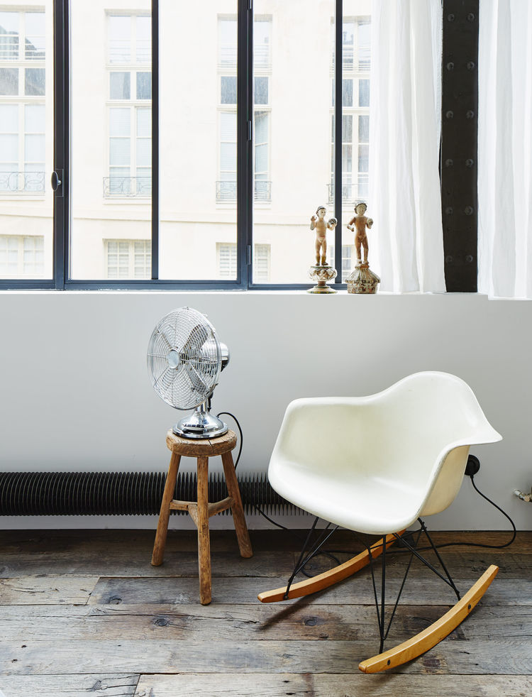 Paris apartment with a vintage Eames rocking chair