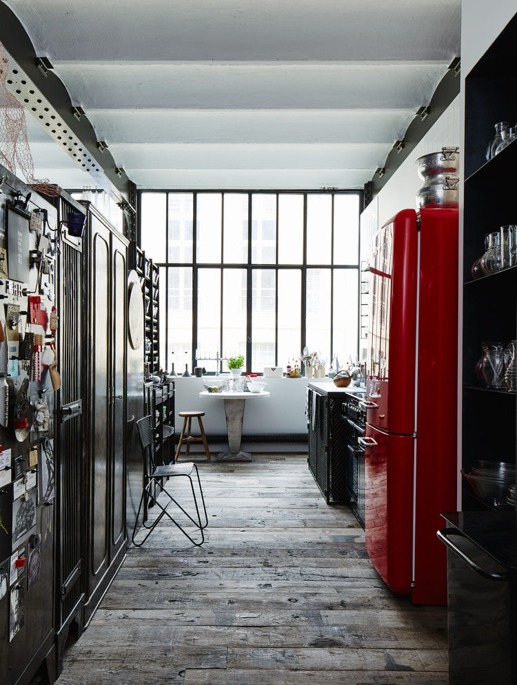 Paris apartment kitchen with a red Smeg refrigerator