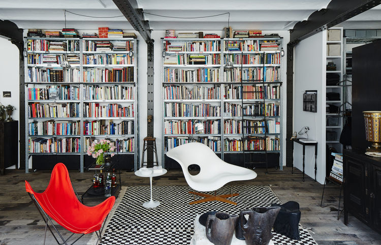 Paris apartment with Eames La Chaise and Moroccan rug