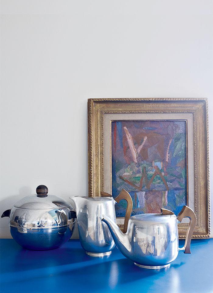 Blue dresser with antique pots in Nicolas Roche's Paris apartment