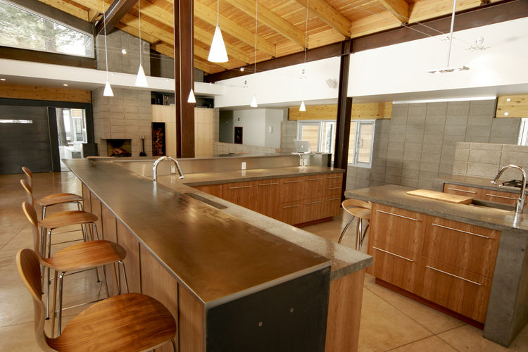 Kitchen with a lengthy steel bar