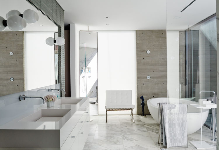 Bathroom with freestanding Po bathtub by Boffi.
