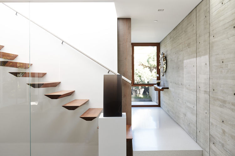 Sculpted walnut stairs in Santa Monica
