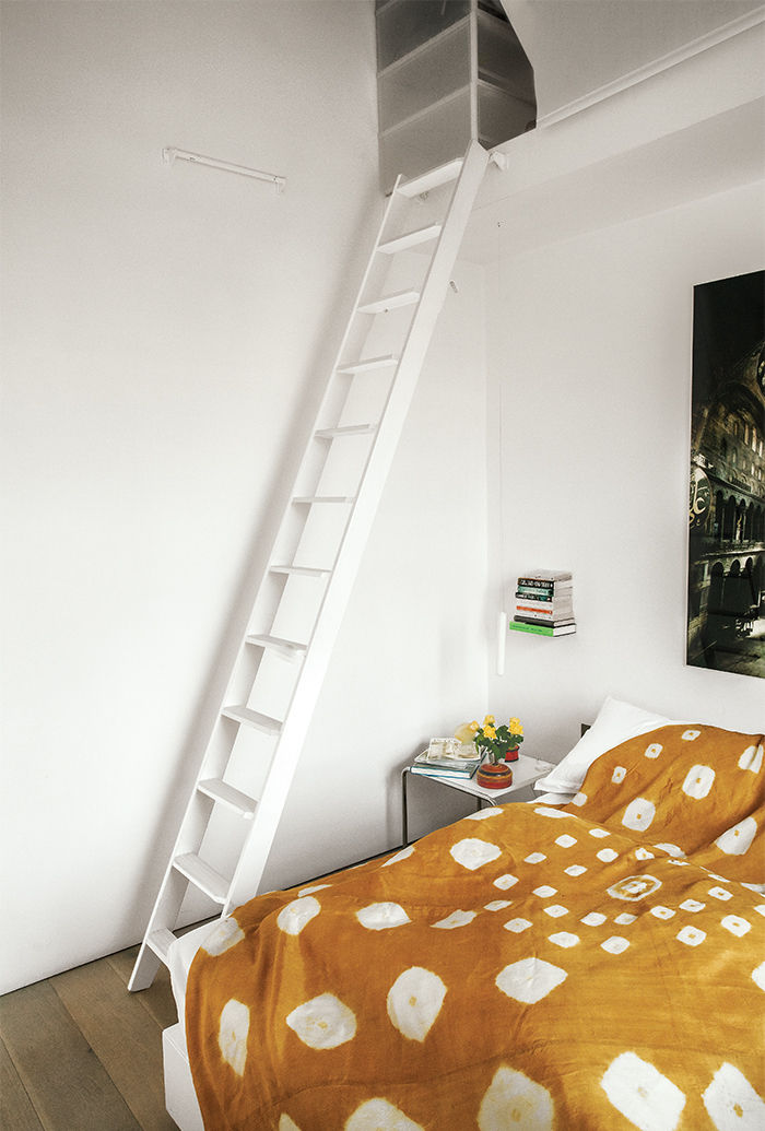 Tiny London apartment renovated bedroom and floor lamp