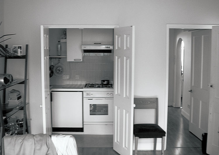 Tiny London apartment renovated kitchen before photo