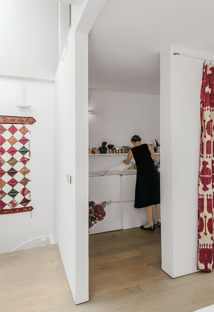 Tiny London apartment renovated kitchen with textiles and blanket