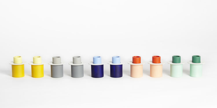 Colorful series of candlestick holders in mixed materials