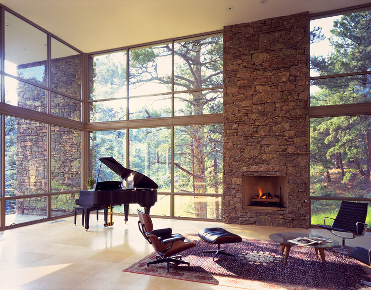 Living room in Colorado home surrounded by ponderosa pines.