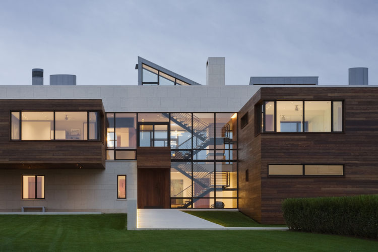 Teak and limestone facade of Hamptons home.