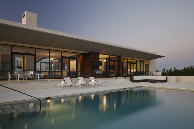 Pool and zinc-clad shading cantilever of modern Hamptons home.