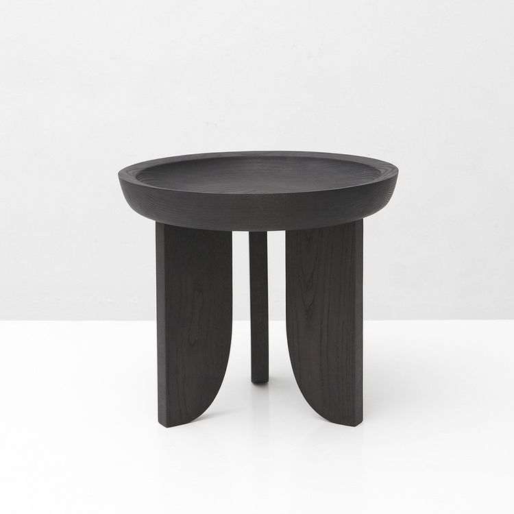 Black side table with bowl-shaped top