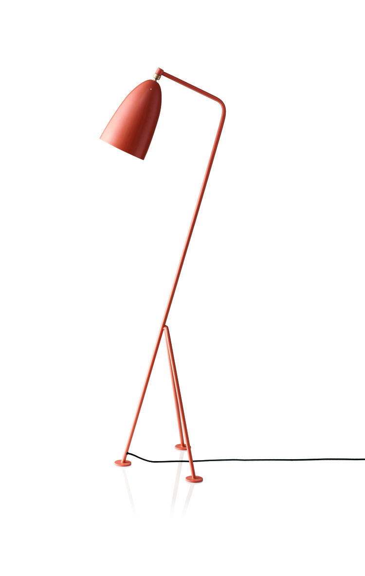 Iconic floor lamp in poised grasshopper shape