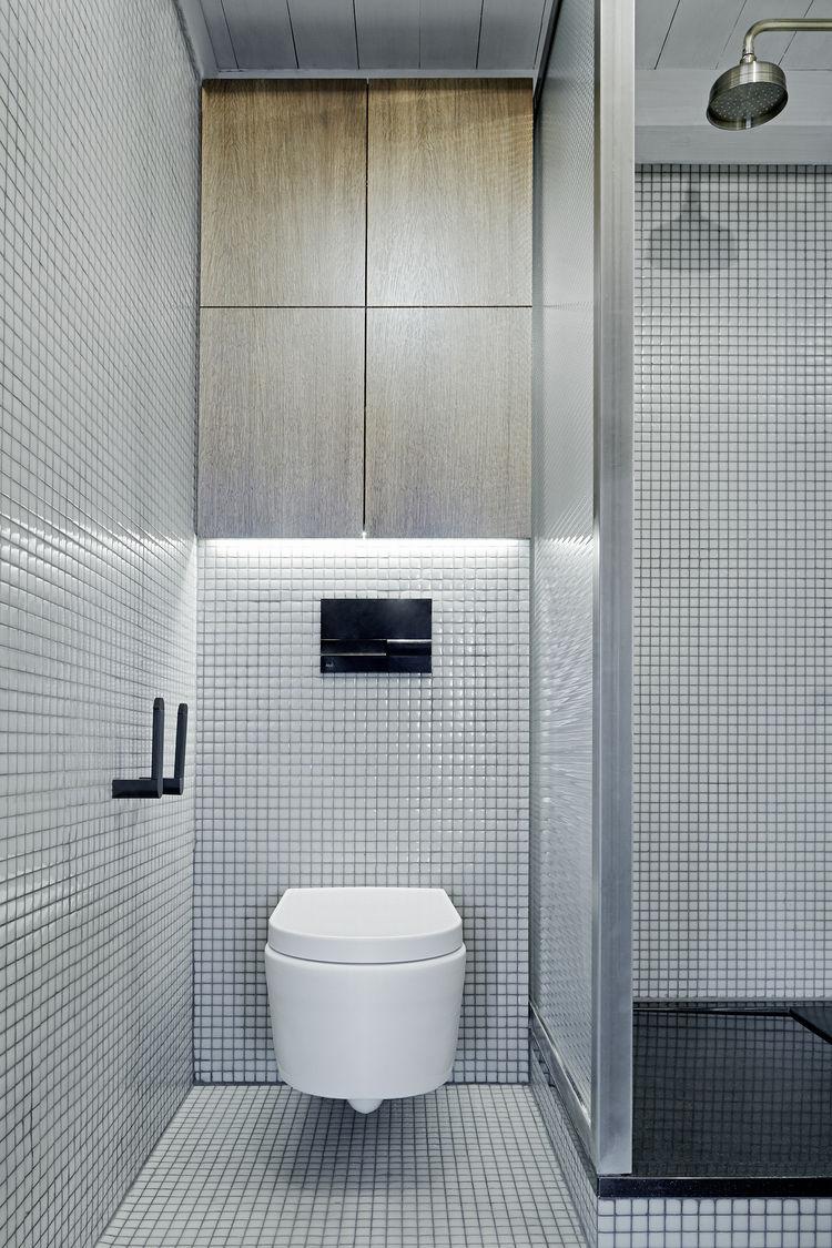 Green-grey Hisbalit tiles in Prague bathroom renovation.