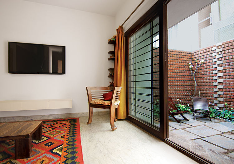 Bangalore, India house living room interior with sliding glass door