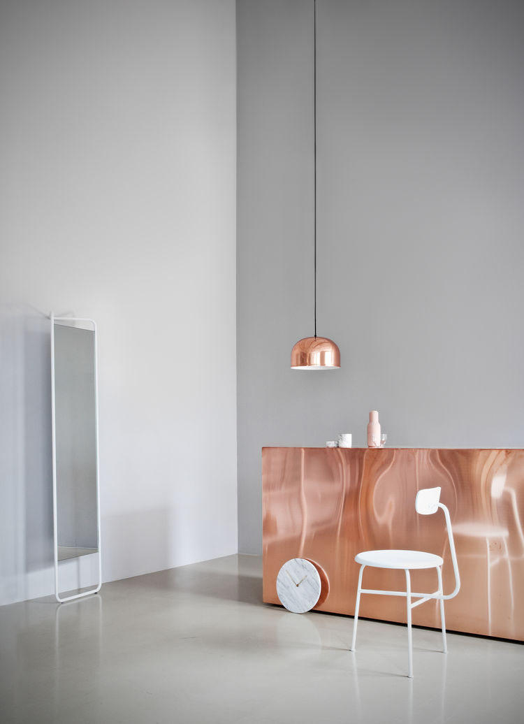 Copper pendant light in neutral space