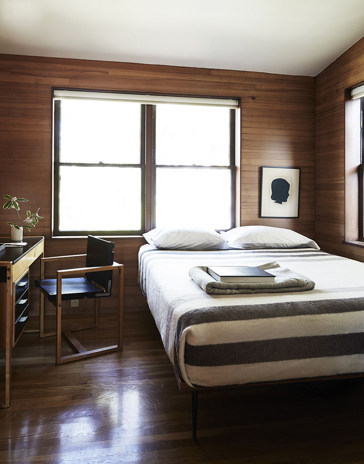 Guest bedroom with wood walls in a Joseph Esherick house