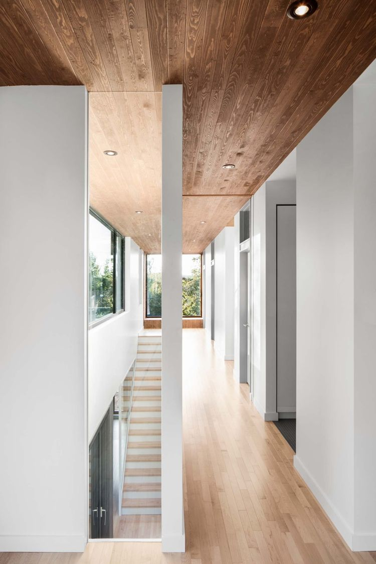 Stained cedar ceilings in Quebec renovation by Naturehumaine.