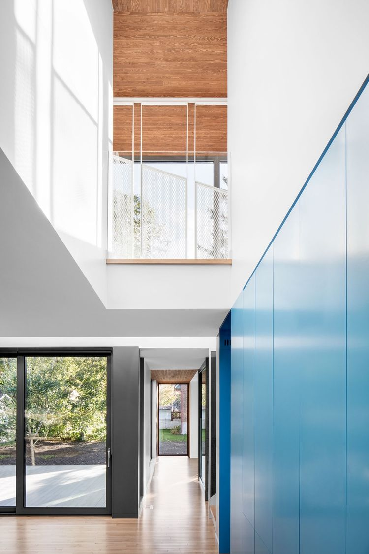 Shalwin windows, maple floors, and steel catwalk by Enfer Design in Quebec renovation by Naturehumaine.