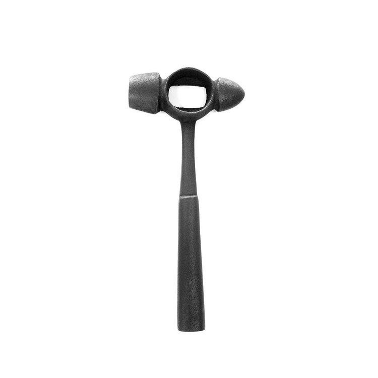 Cast iron bottle opener in shape of tool
