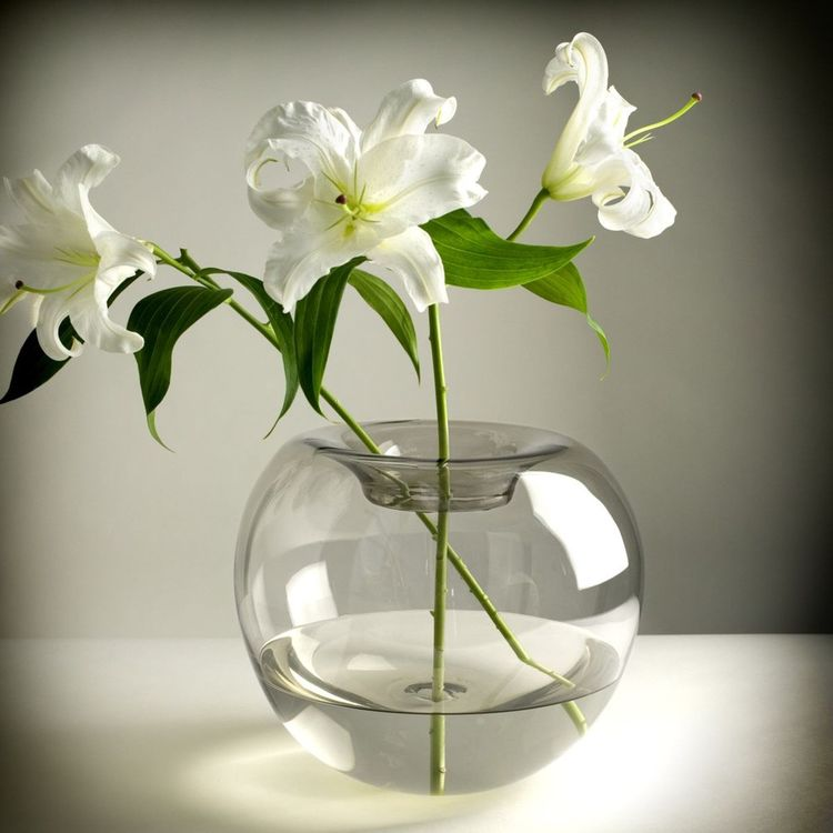 Elegant handblown glass vase with spherical silhouette