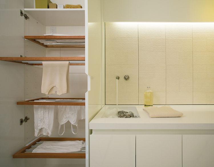 Modern laundry room with hidden custom drying rack